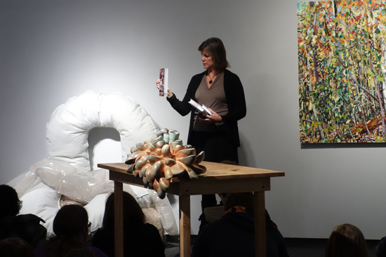 "Carolyn with her piece ""OK"" on left. Work by Pamela Theis in foreground, work by Lilian Garcia-Roig on right."
