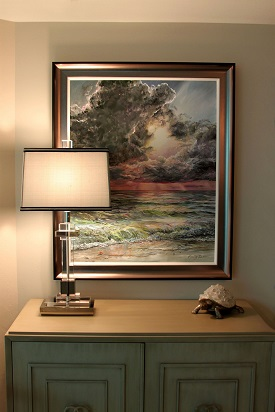 "....and the scene below was painted knowing the lamp was going to be there to highlight the texture in the painting. Their Gulf front view affords constant enjoyment of the changing sky, and so I created this dramatic scene, titiled, ""Silver Lining""..."