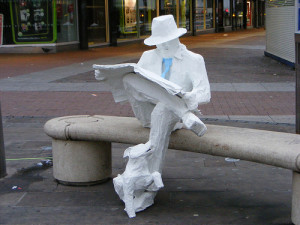 Paper_Mache_Man_Reading