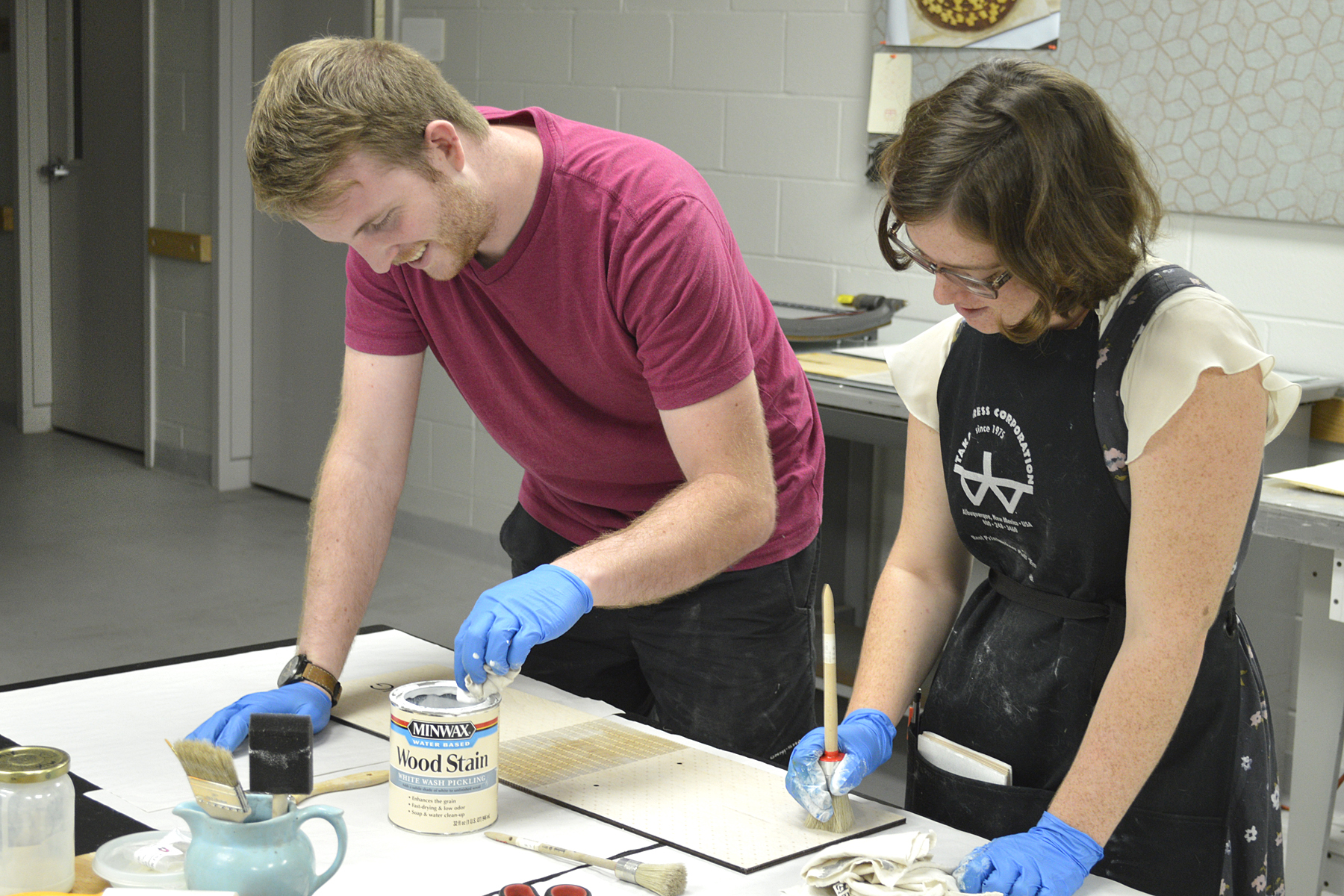 Working at the Facility for ArtsVolunteer, Landon Perkins, and intern, Alexis Buechler, working on the artists' book, Lining.