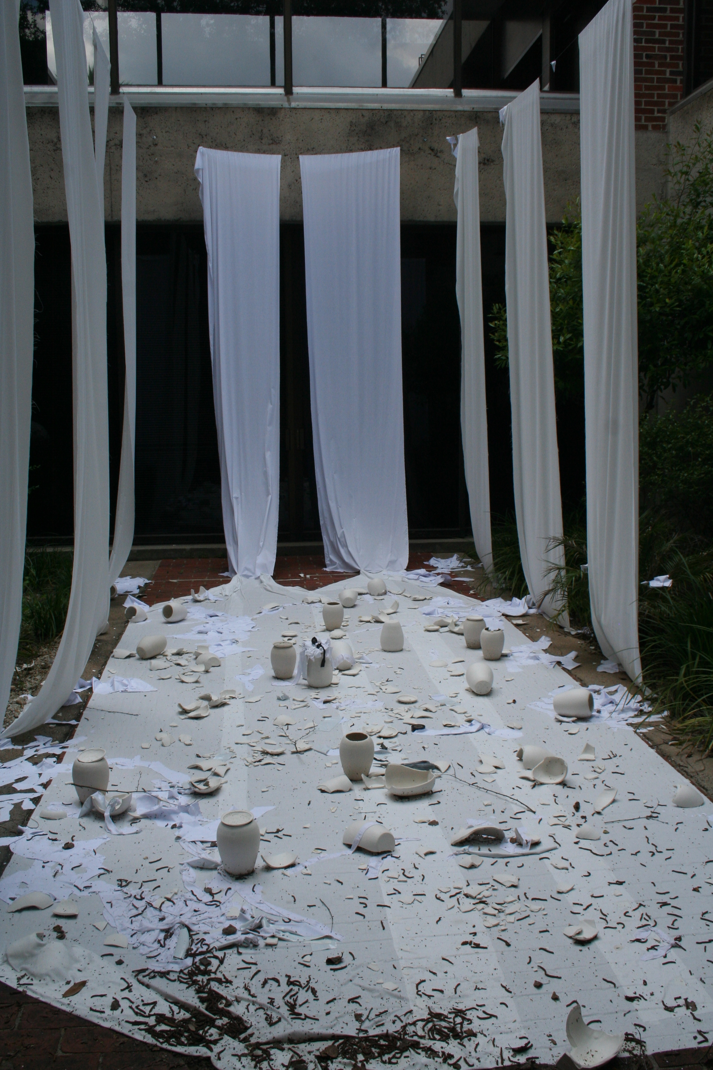 several broken pieces of pottery scattered on a white blanket