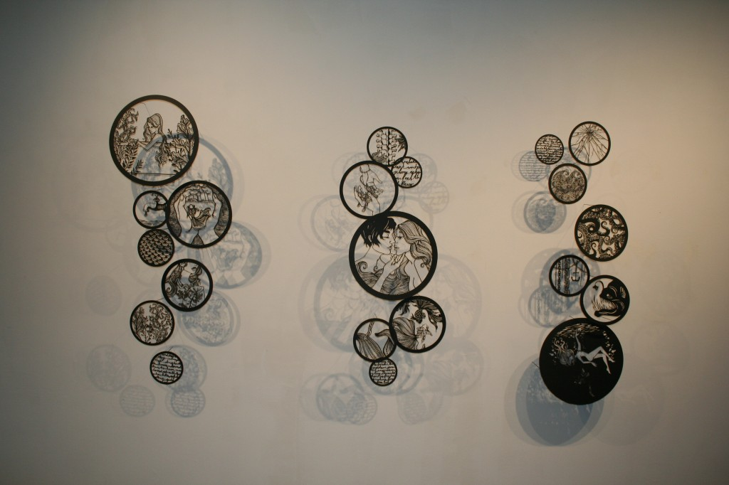 circular laser cut illustrations on a wall