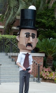 student wearing a large cardboard head