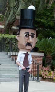 student wearing a large cardboard head