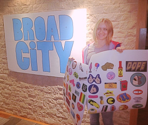 Here's a really bad photo of me holding up my sticker designs precut at the office
