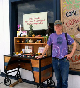 Associate Professor Paul Rutkovsky on the road with the Doodle Cart.