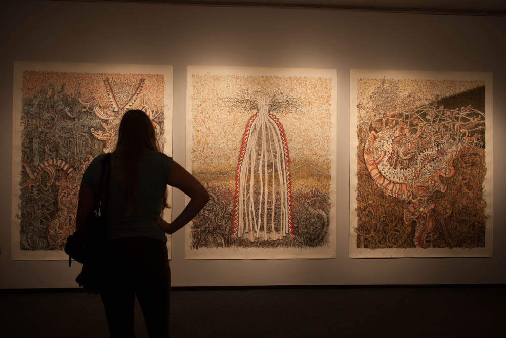 single woman in front of gallery image