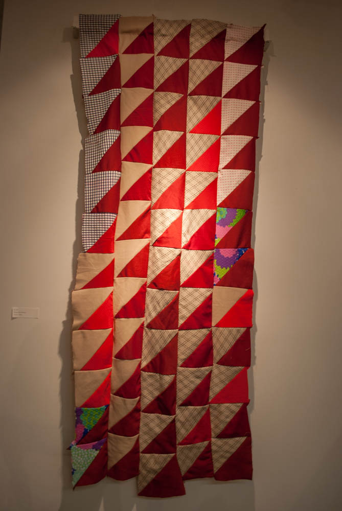 Photo of red and beige quilt with patterns