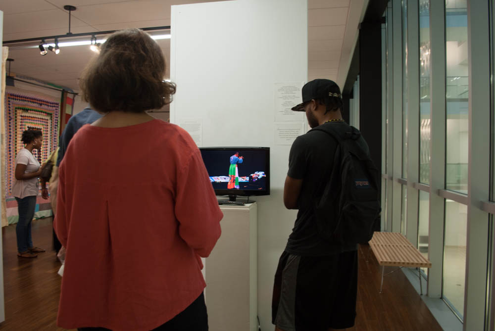 Two people watching a video by Ms. Hill