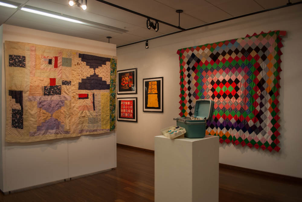 Angled view of quilts and Ms. Hill's sewing supplies