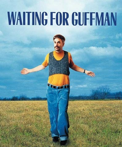 """A man with the words """"Waiting for Guffman"""" above him"""