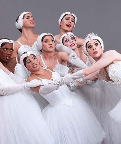 Women with shocked faces in white dance clothing