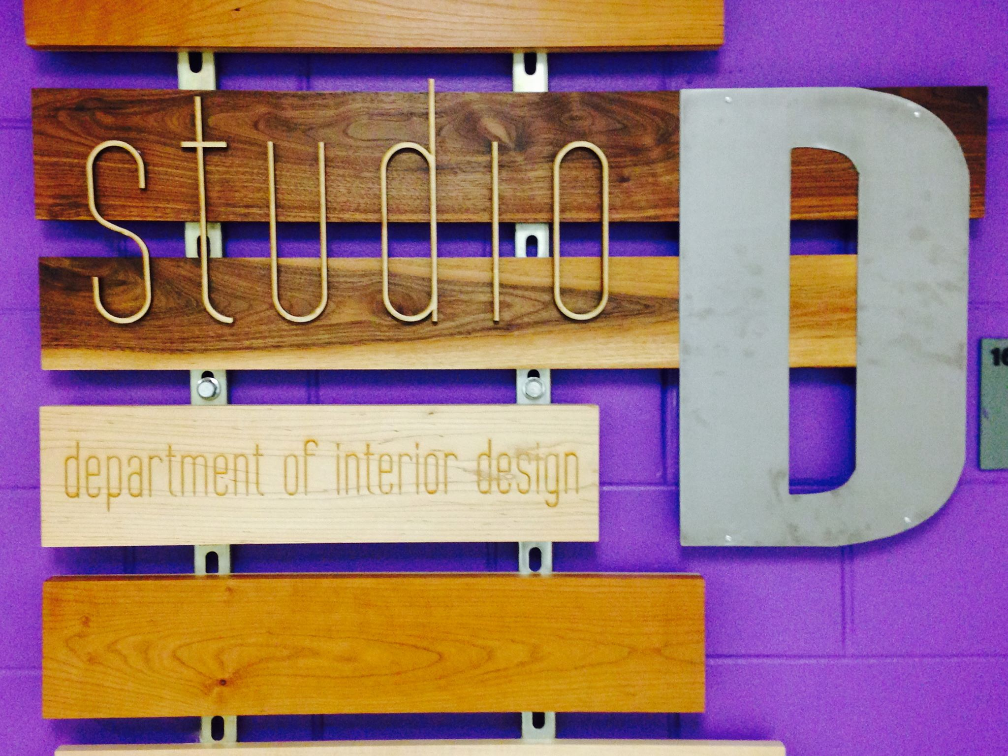 """Frontal photo of """"Studio D"""" sign"""