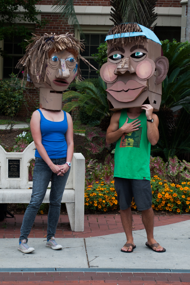 Two students with cardboard heads