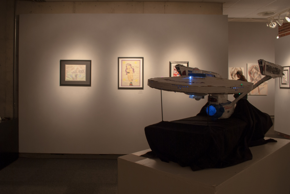 Angled shot of artworks and the Enterprise