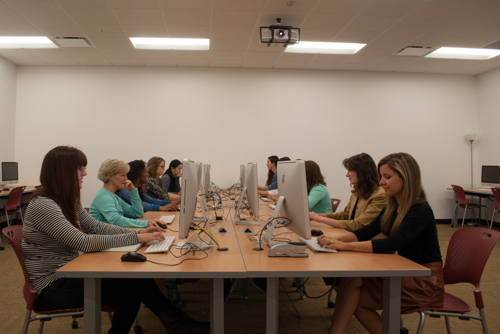 Frontal photo of students sitting at computers
