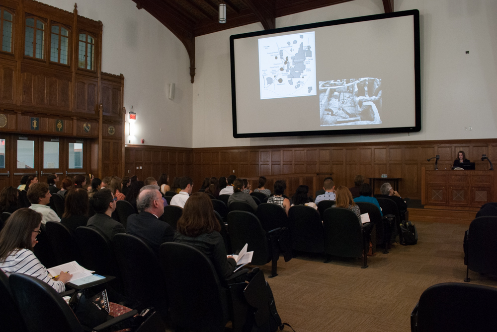 Angled shot of lecture hall with speaker