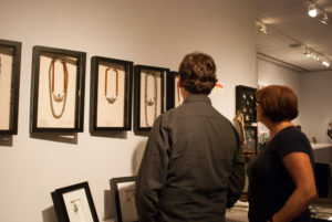 Back shot of of customers looking at items