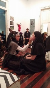 Monique Boileau and Ellen Holbert paint each others faces in preparation for the performance.