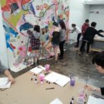 Students painting.
