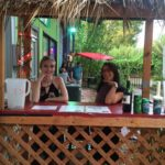 Working the tiki hut with Courtney.