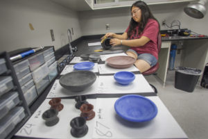 3D printing of archaeological artifacts to display in an upcoming exhibition at Museum of Fine Arts. Christina Cha, a PhD student in Classical Archeology, sands some of the 3D printed replicas.