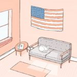 A patriotic cat sits below its flag