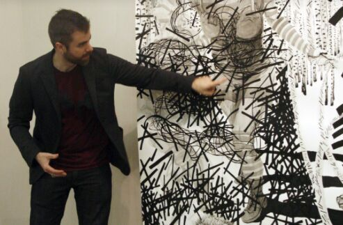 Matt Miley demonstrating the lines in his work as neurons