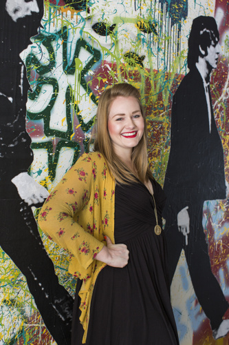 Kathryn Godwin in front of the John Lennon Wall