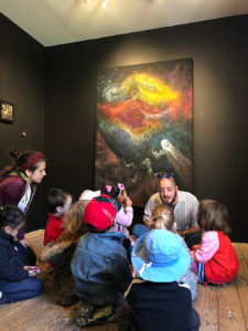 Alexander speaks with children about art.