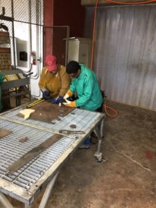 Helping a student with Plasma Cutting